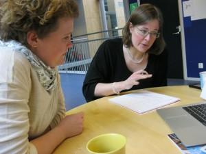 Camilla Ländin och Maria Kullberg planerar inför Arbetslivets Dag. Lisbeth Rydén bakom kameran.